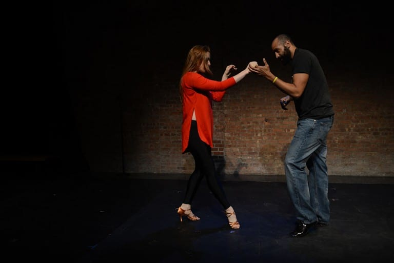 Man and Woman dancing in theater.