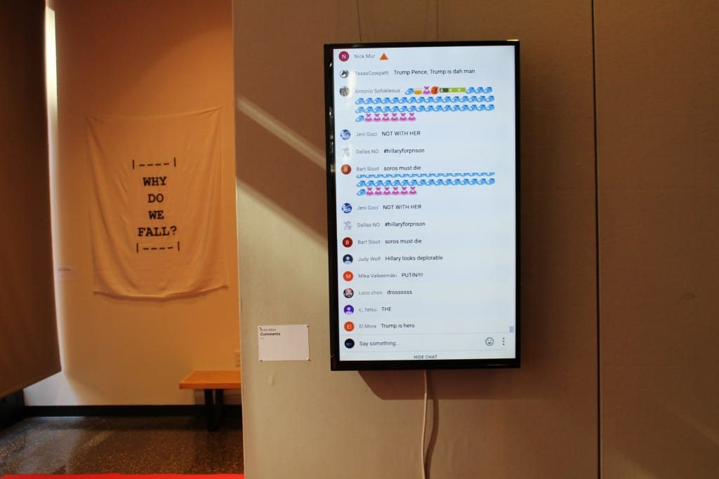 Monitor in Gallery space with screen showing various online comments.