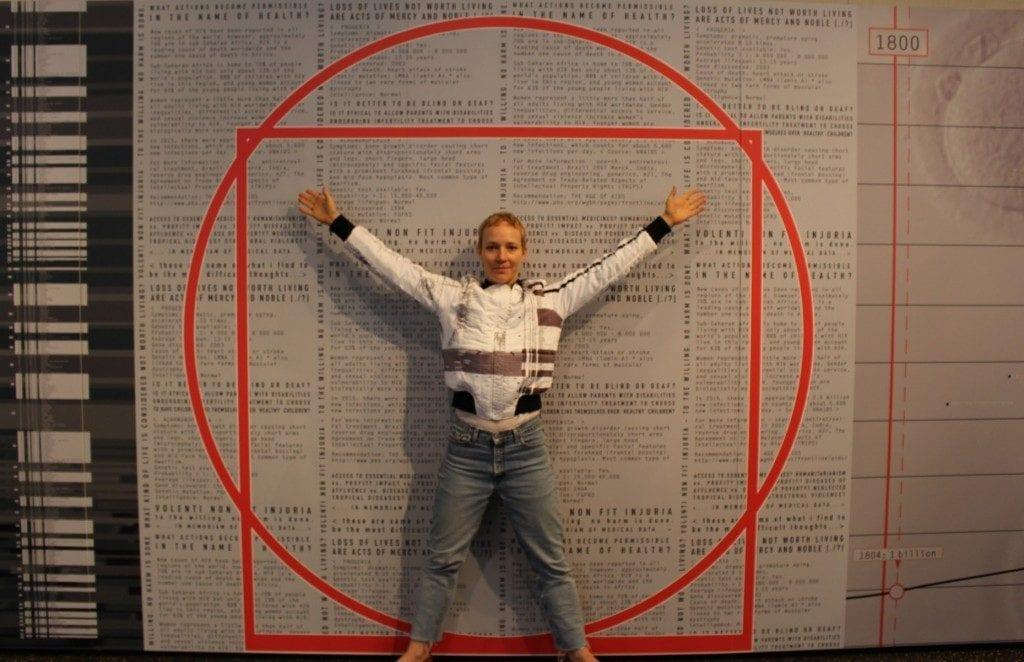 Woman posing infront of artwork