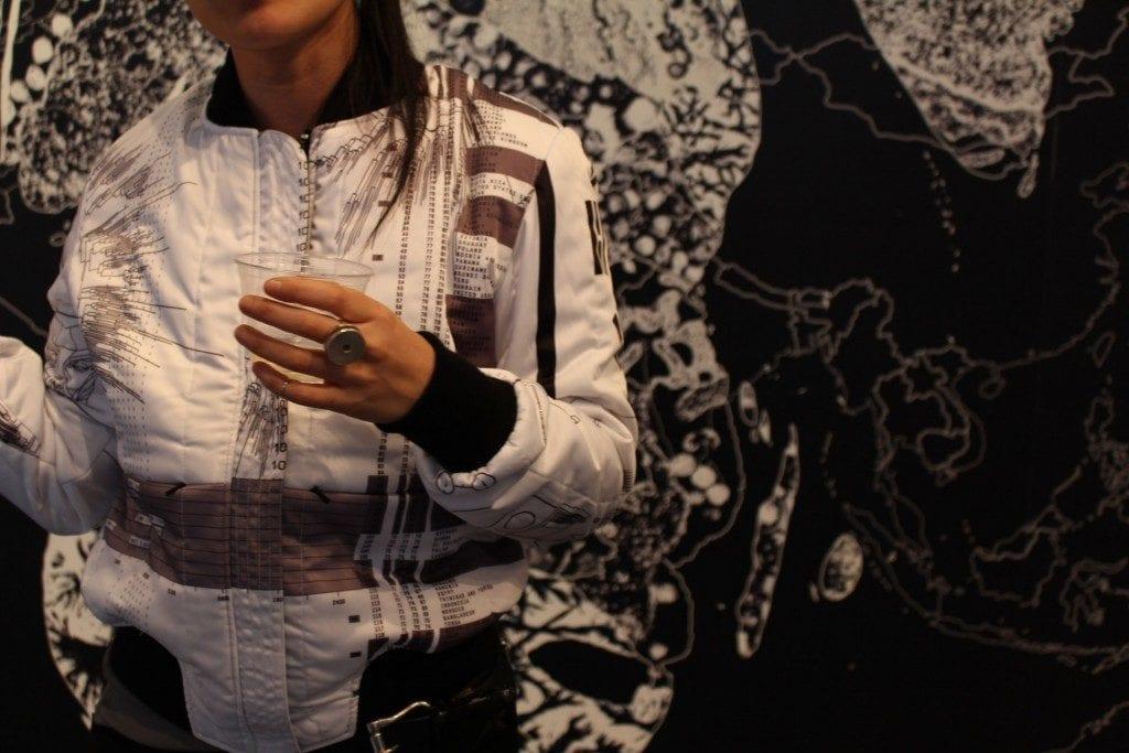 Detail shot of woman wearing designer bomber jacket