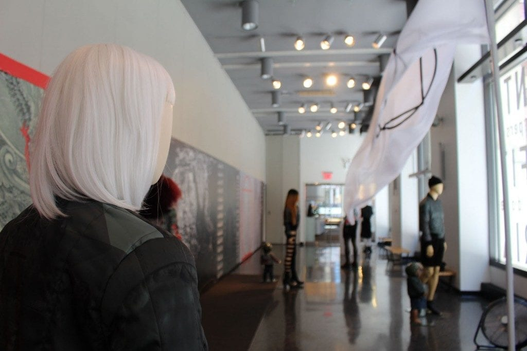 Gallery Space: mannequins dressed with designer artwork and wigs