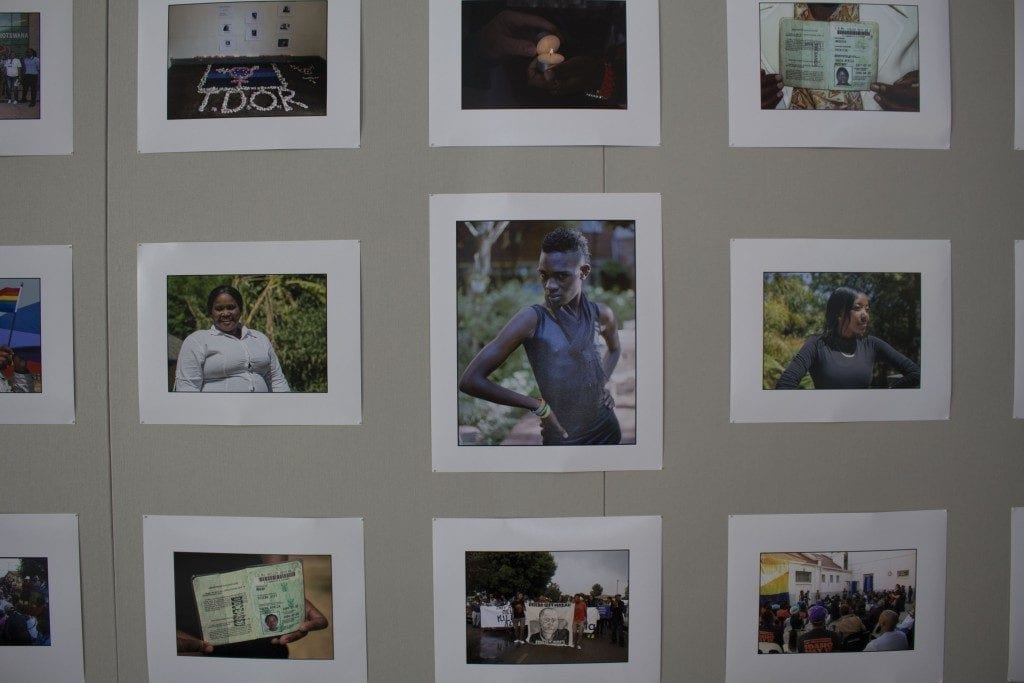 Gallery Wall: Various photographs displayed with African subjects