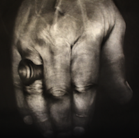 Close up black & white image of hand with ring