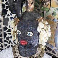Sculpture made of shells and beads of woman.