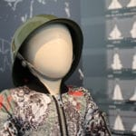 Mannequin with bomber jacket and war hat.