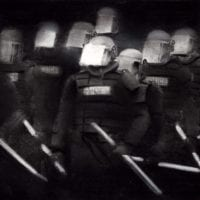 Black & white photograph of swat team