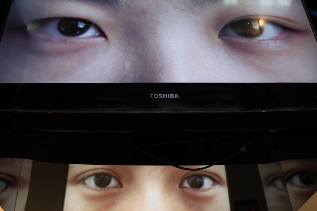 Image of eyes on two monitors