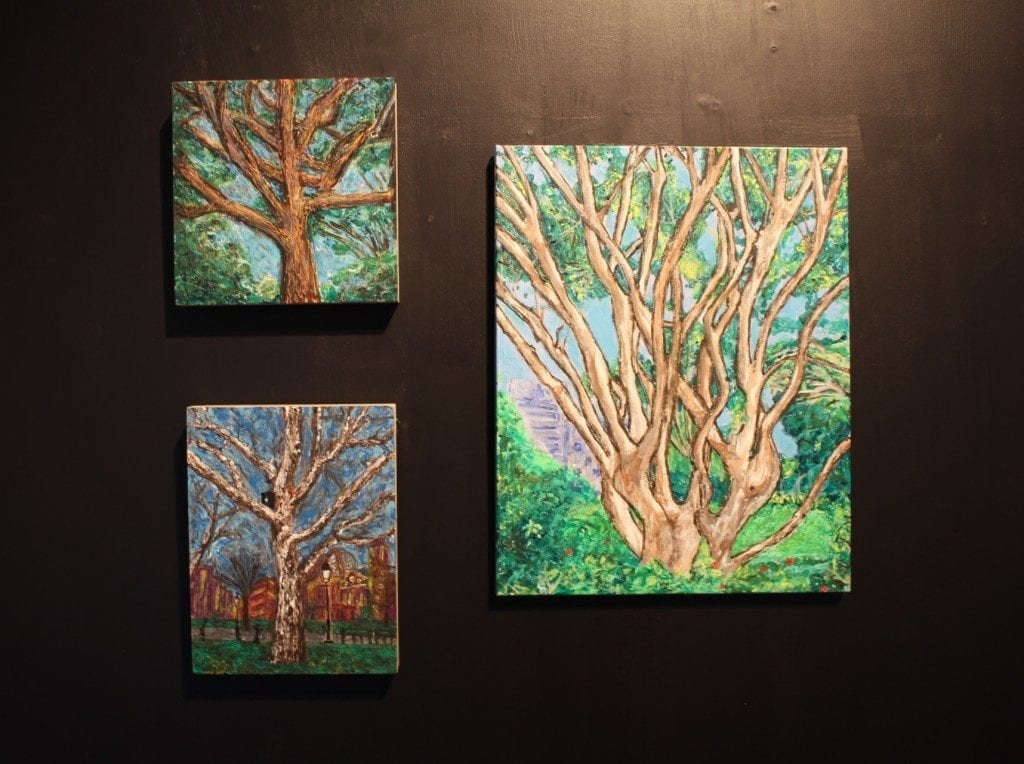 Gallery wall: three paintings of trees.