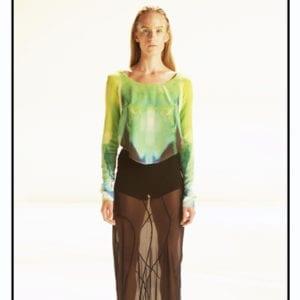Studio Portrait of young white woman wearing designer garments