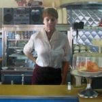 Portrait of woman behind a counter in a diner