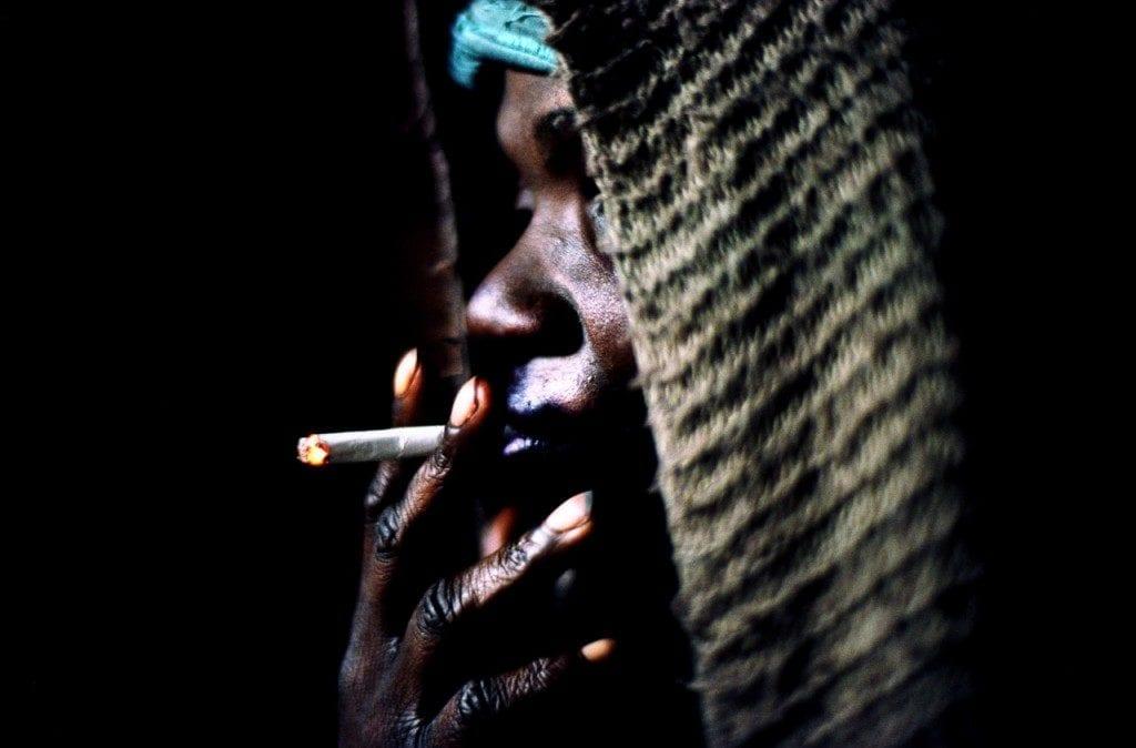 Close up of a black woman smoking a cigarette