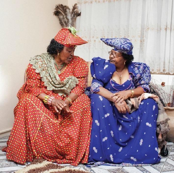 Two women in bright elegant dresses