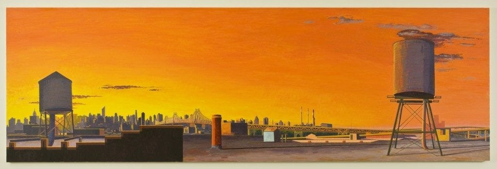 Panoramic print of sunset and cityscape.