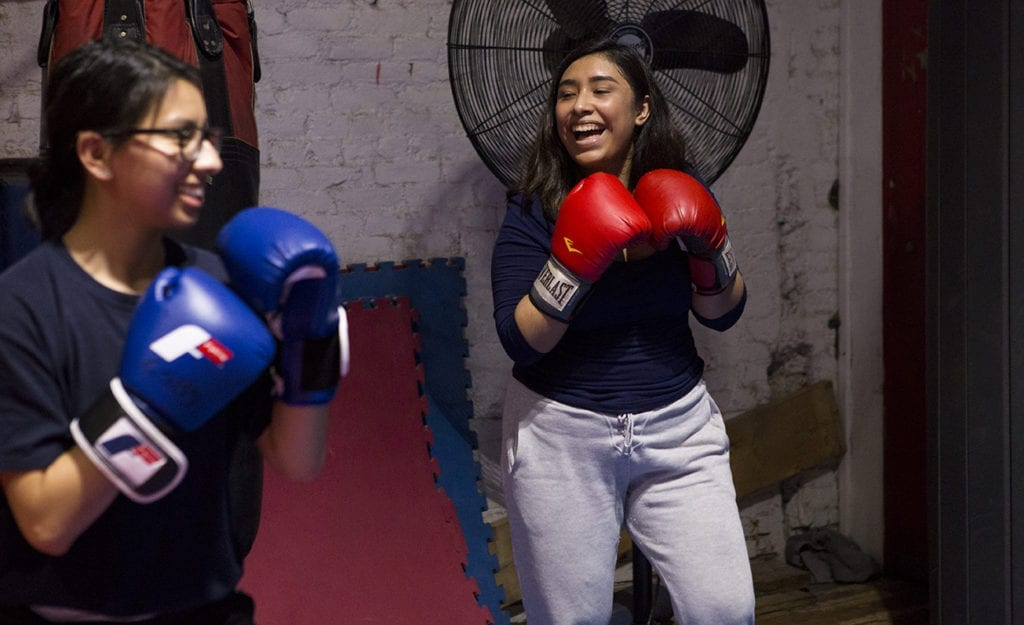Girl laughing while boxing