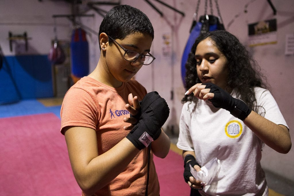 Two girls in a boxing studio.