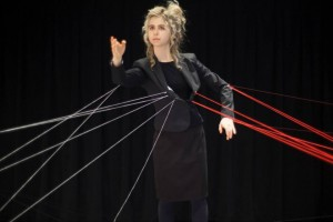Woman with strings attached to body