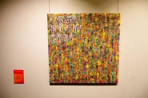 "Art piece reads ""Carpe F*ckin Diem"" with colorful background"