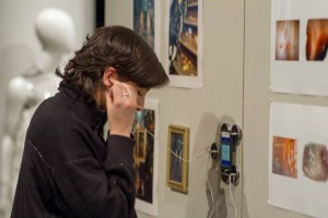 Woman listening to audio playing in gallery