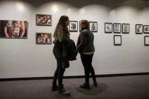 People enjoying art work on opening night