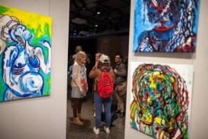 People looking at art work