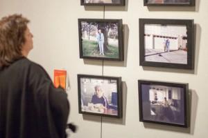 Woman looking at gallery photos