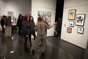 People conversing in gallery space