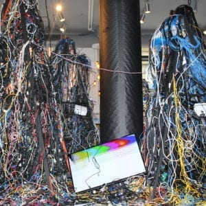 Sculpture made out of wires and a broken TV screen