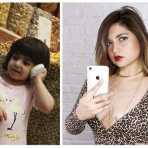 Little girl using phone on left, older woman taking selfie on right