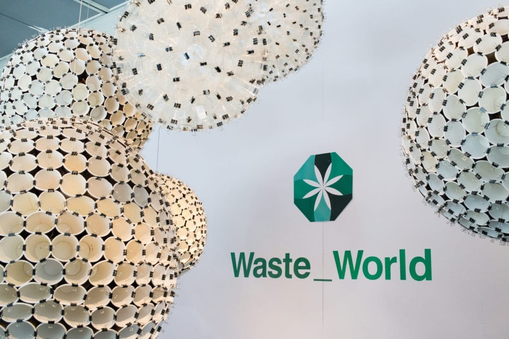 waste world logo and paper cup sculptures