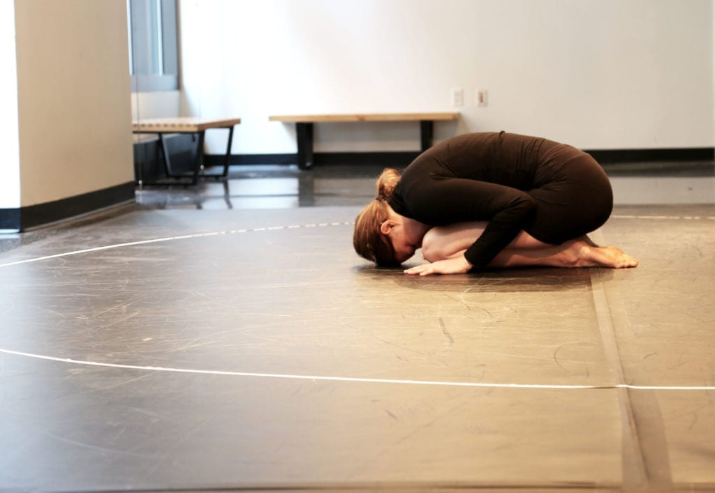 woman on the floor in a child's pose position