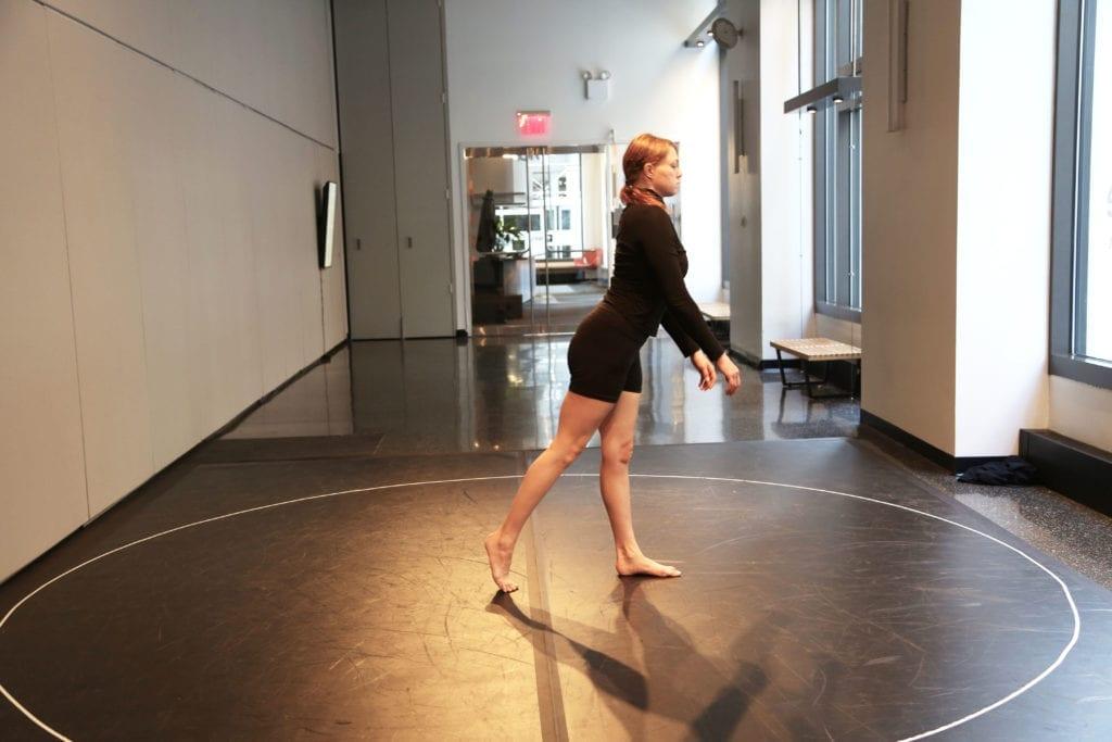 woman wearing black stepping forward