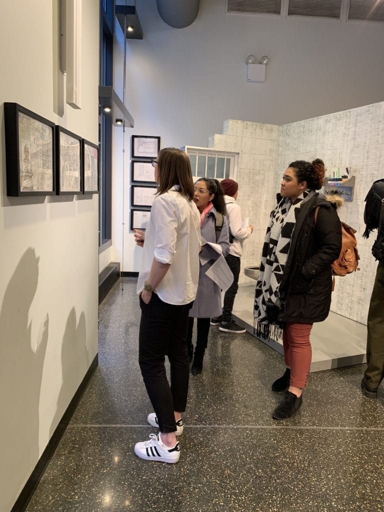 people viewing art at the reception in the gallery