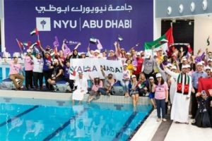 NYUAD community members gather on the pool deck to wish Nada Al Bedwawi good luck in Rio. Michelle Loibner / NYUAD