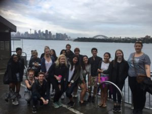 NYU Sydney Environmental Journalism students at Taronga Wharf overlooking Sydney Harbour