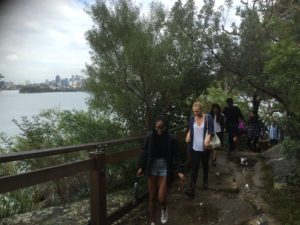 NYU Sydney Environmental Journalism students on the Sydney Harbour foreshore, walking through protected bushland