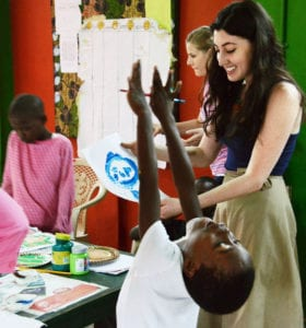 Interns making art with children in Ghana