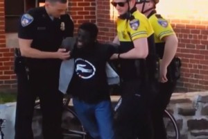 A still from the cell phone video taken of Freddie Gray's arrest, showing him clearly in pain.