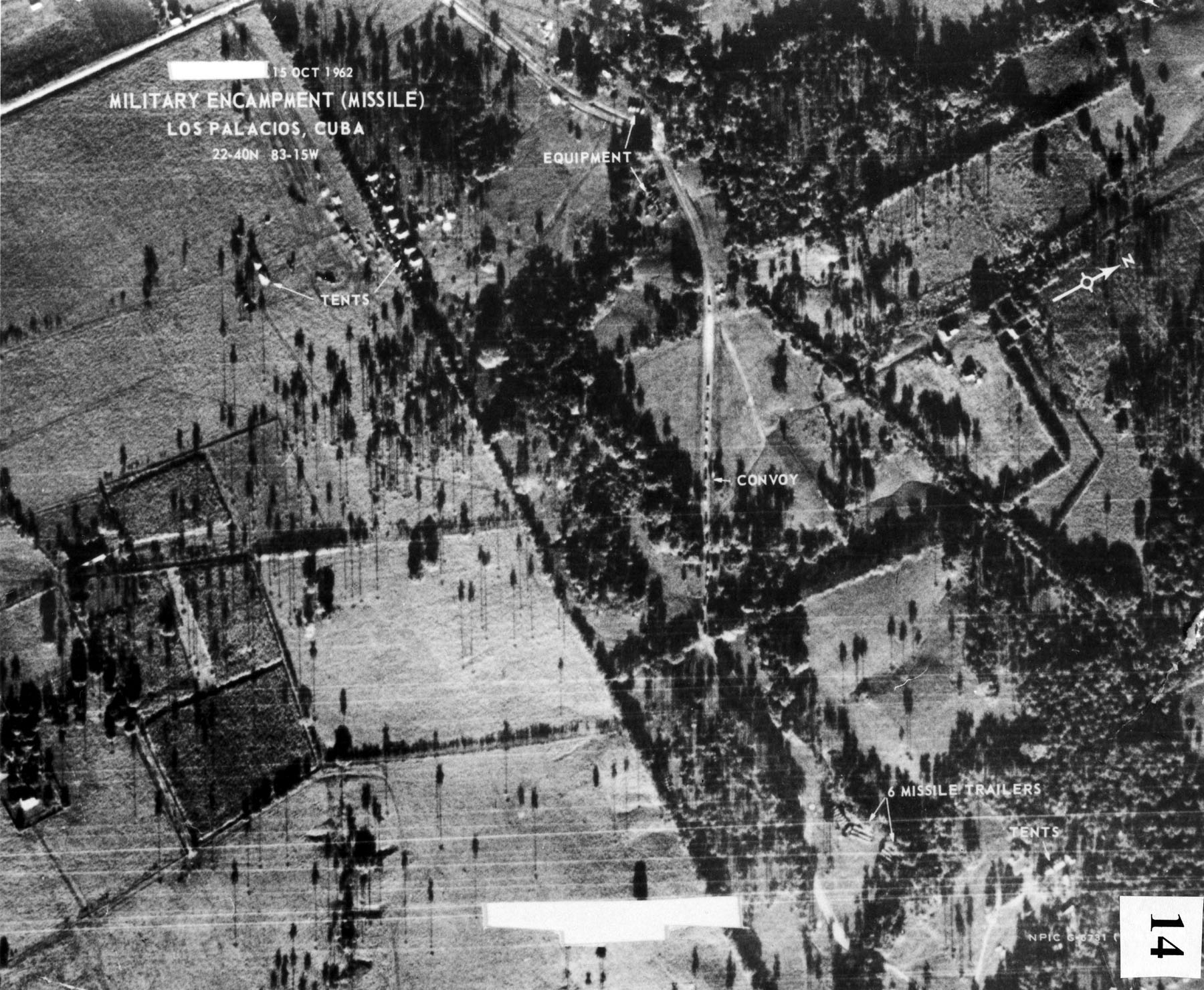 Soviet truck convoy deploying missiles near San Cristobal, Cuba, on Oct. 14, 1962. This image, taken by Maj. Steve Heyser in a USAF U-2, is the first picture that proved Russian missiles were being emplaced in Cuba. The image is dated on the day it was printed. (U.S. Air Force photo)