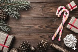 Decorative screenshot showing candy canes, small gold pine cones, small gifts in gold wrapping paper with red ribbon and holiday garland