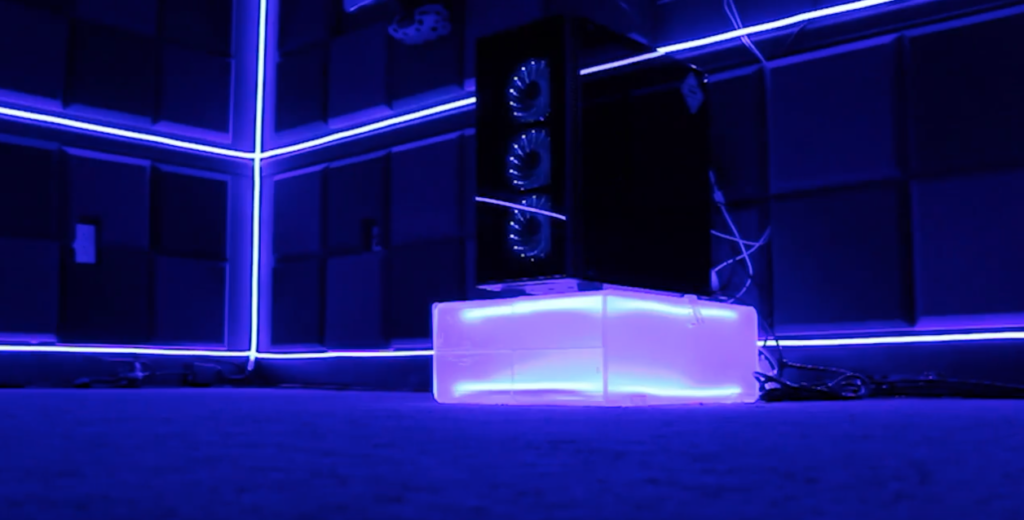 Holocube VR console hardware lit up by blacklights.