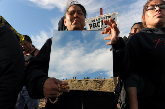 A protester holds up a mirror during a protest of the Dakota Access pipeline near the Standing Rock Indian Reservation near Cannon Ball, North Dakota November 6, 2016. (Photo by Stephanie Keith/Reuters)