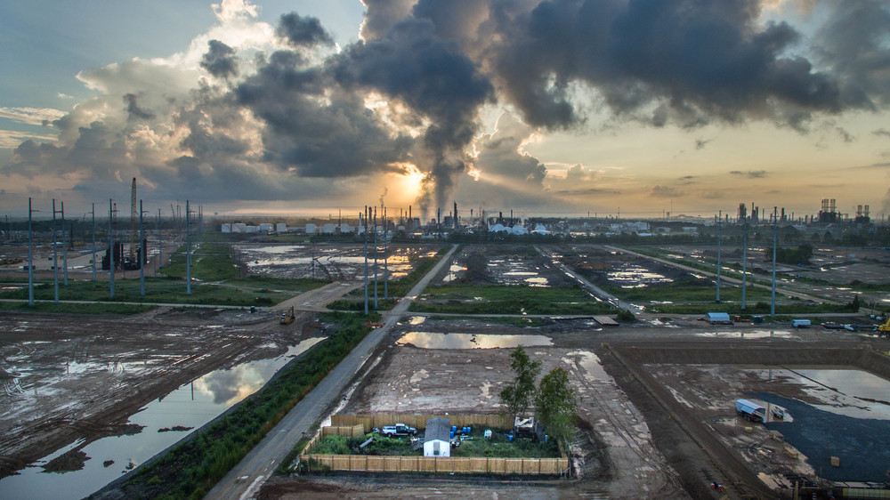 Photo f the chronically polluted industrial skyline of Mossville, near Lake Charles in Calcasieu Parish by Alexander John Glustrom