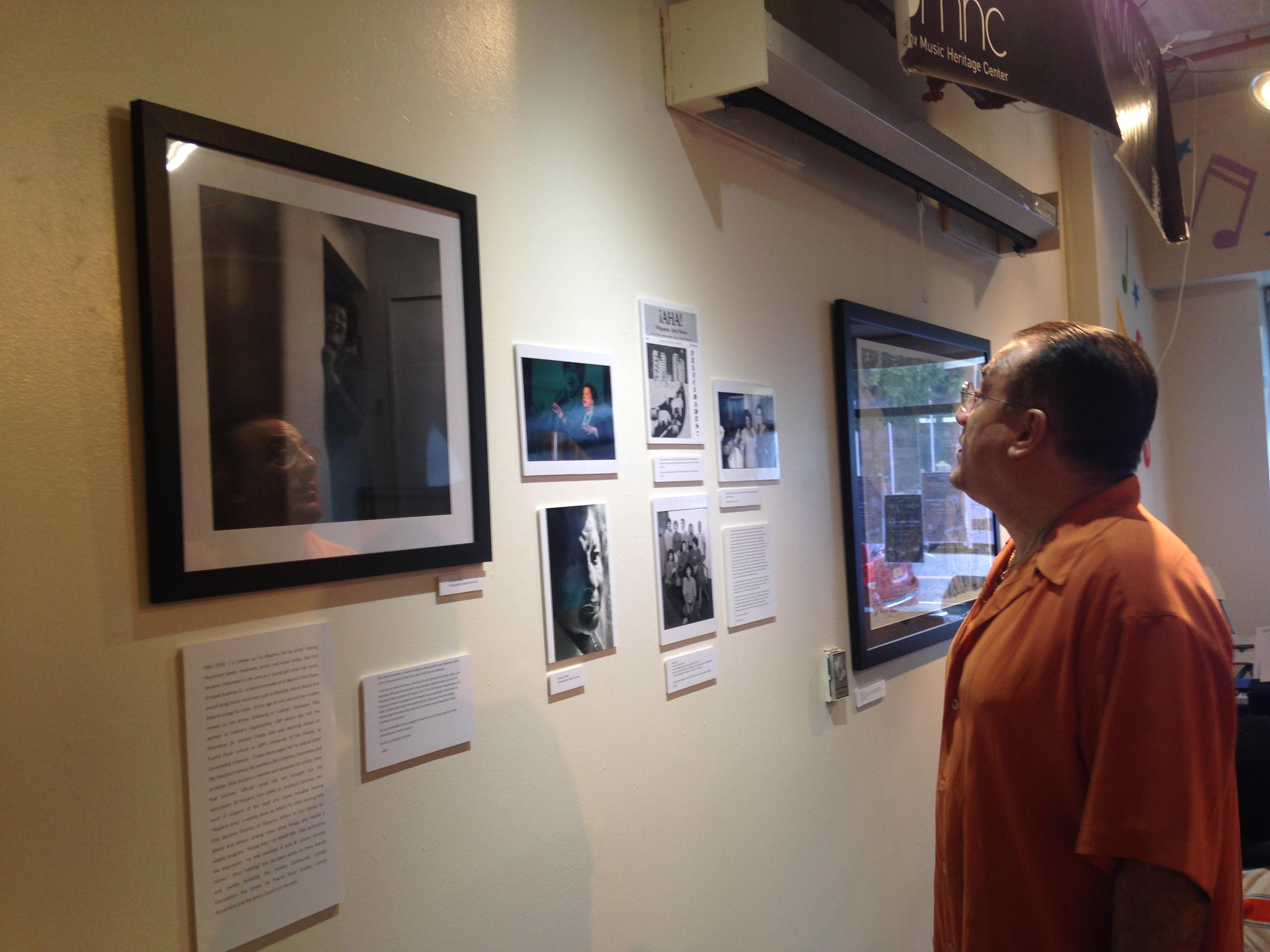 "BMHC Co-Artistic Director Bobby Sanabria viewing the ""Las Tres Hermanas"" exhibit."