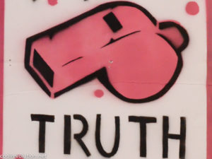 """Graffiti of pink whistle with word """"truth"""" underneath"""